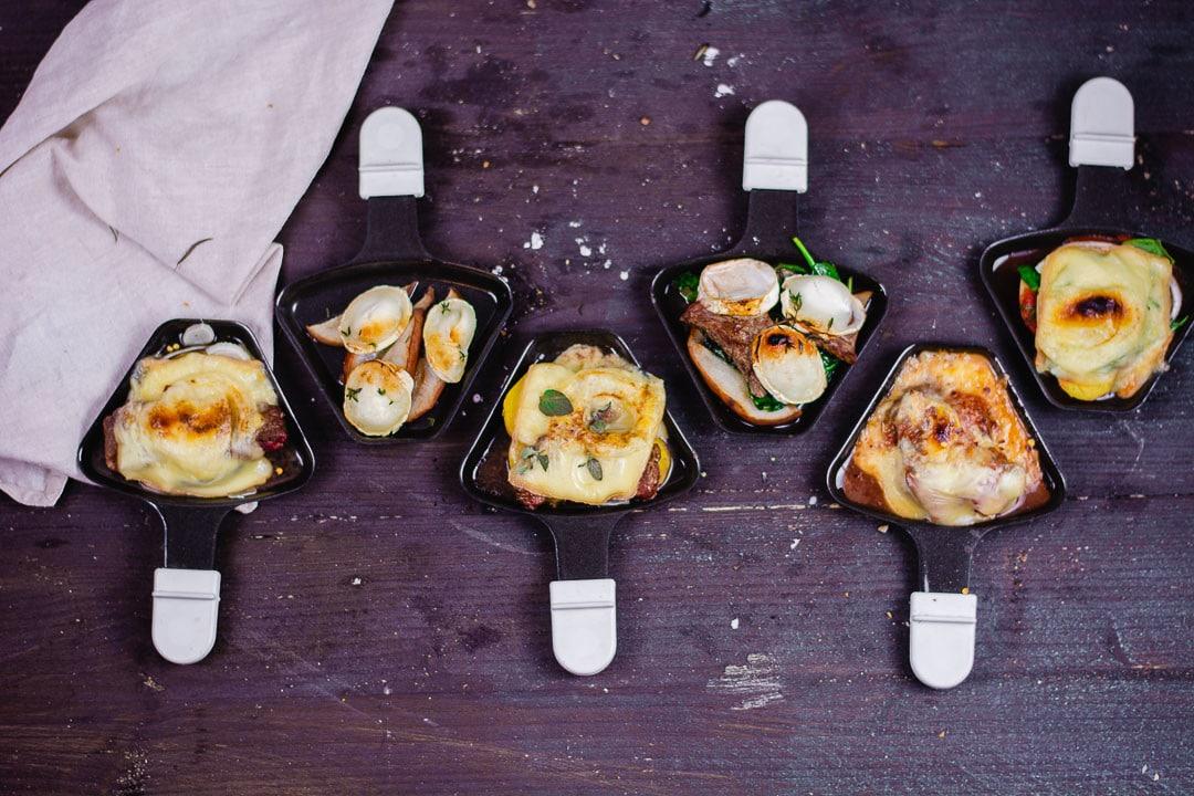 Verschiedene Raclette Ideen in sechs Pfännchen